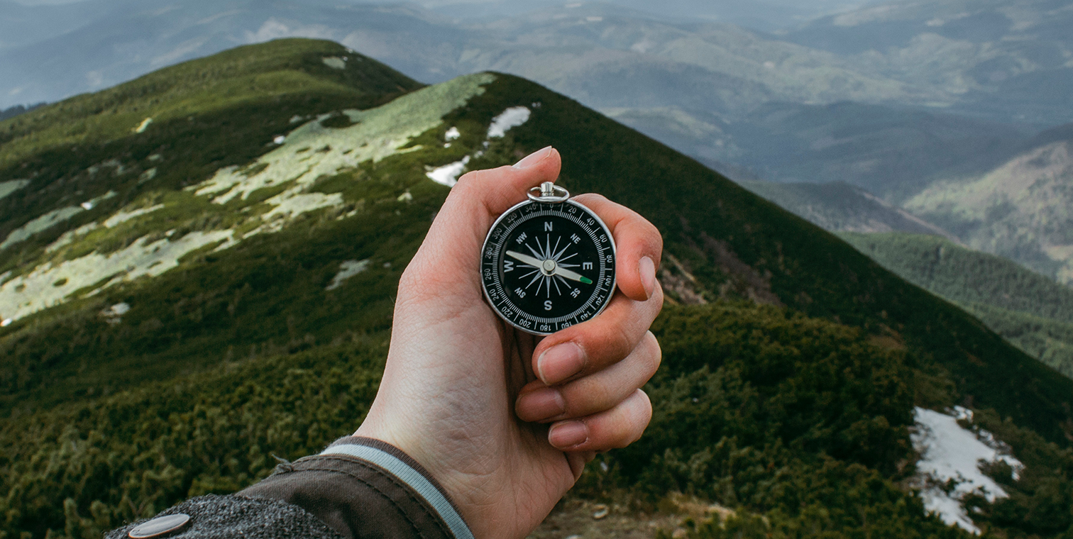 photo of a hand holding a compass